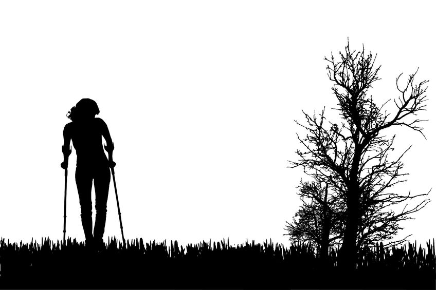 29381594 - vector silhouettes of people walking on crutches.